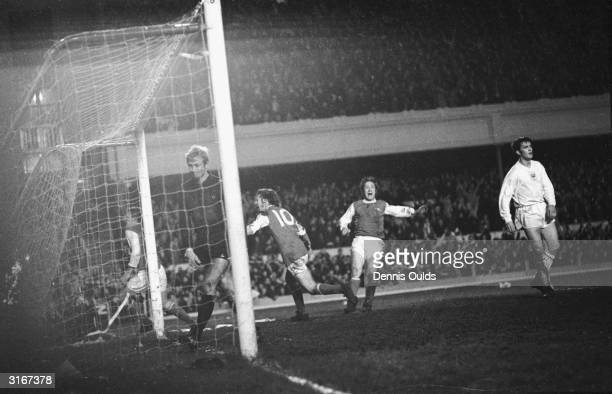 Arsenal's John Radford rushes past the goalpost after scoring against Anderlecht in the Fairs Cup Final at Highbury Charlie George and George...