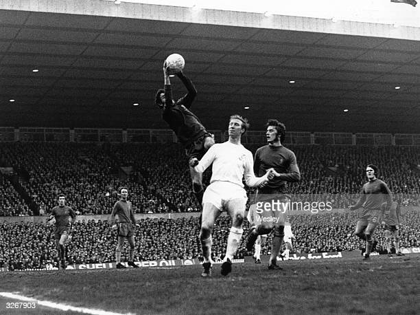 Chelsea goalkeeper Peter Bonetti leaps high to grab the ball from Jack Charlton of Leeds United during the FA Cup Final replay at Old Trafford...