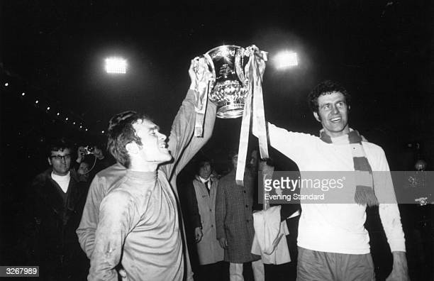 Chelsea players Peter Osgood and Ron Harris lift the FA Cup trophy in celebration after beating Leeds United 21 after extra time in the FA Cup Final...