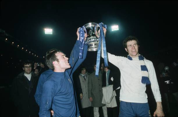 Chelsea's Ron Harris and Peter Osgood lift the FA Cup trophy in celebration after beating Leeds United 2-1 in the FA Cup Final replay at Old Trafford.