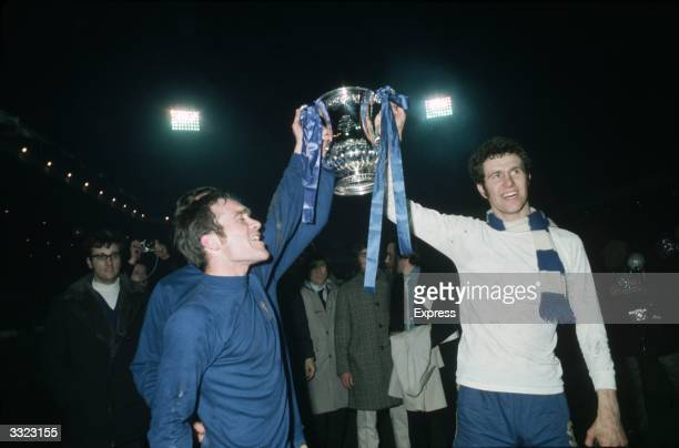 Chelsea's Ron Harris and Peter Osgood lift the FA Cup trophy in celebration after beating Leeds United 21 in the FA Cup Final replay at Old Trafford
