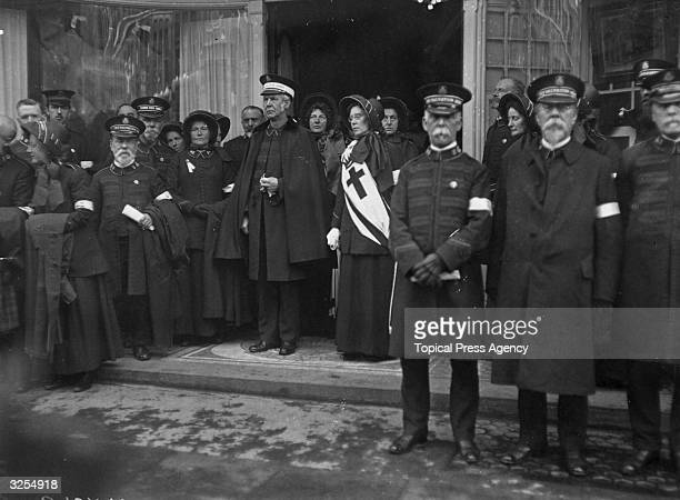 William Bramwell Booth general of the Salvation Army surrounded by other members at the funeral of his father William Booth founder of the movement