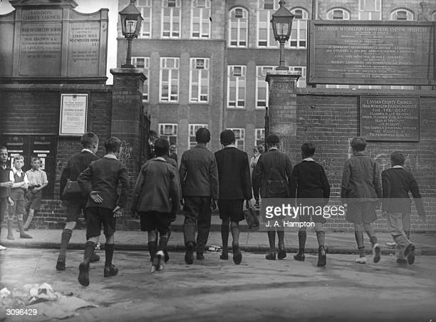 London County Council elementary schoolchildren running into the playground at Hugh Middleton School in Clerkenwell London