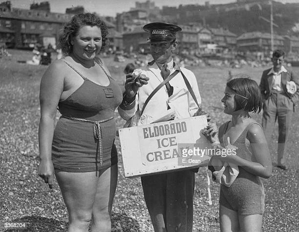 Eva Morrison who is waiting for suitable conditions for a Channel swim attempt at Dover Kent buys an icecream for her young mascot Beryl Brooks aged 7