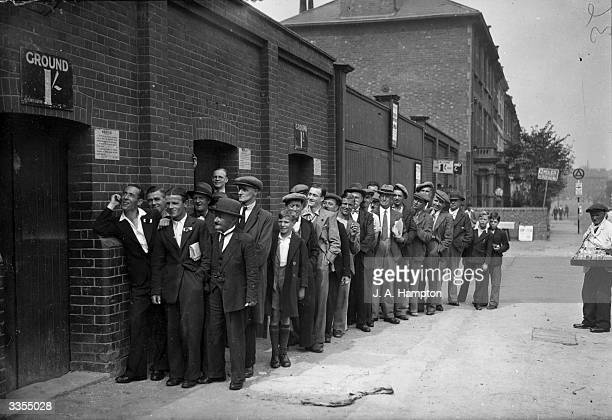 Football fans queue up outside the Arsenal ground at Highbury London three hours before kickoff in the Arsenal versus Everton match