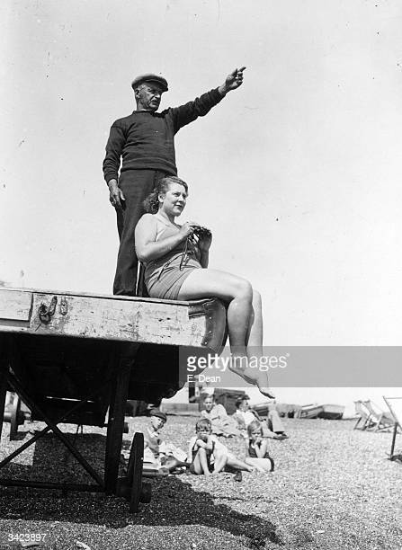 Standing on the beach at Dover trainer Charles Cole points in the direction of France to US swimmer Eva Morrison who plans to swim the English Channel