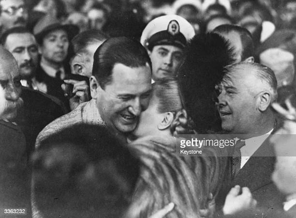 A smiling Juan Peron the Argentine president greets his wife Eva Peron on her arrival home in Buenos Aires from Europe