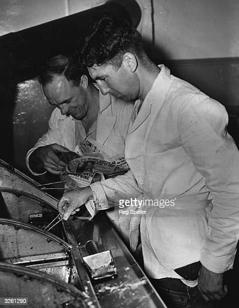 Queens Park Rangers footballers Albert Smith and Arthur Jefferson working together in their jointly run fish and chip shop in Melina Road Shepherd's...
