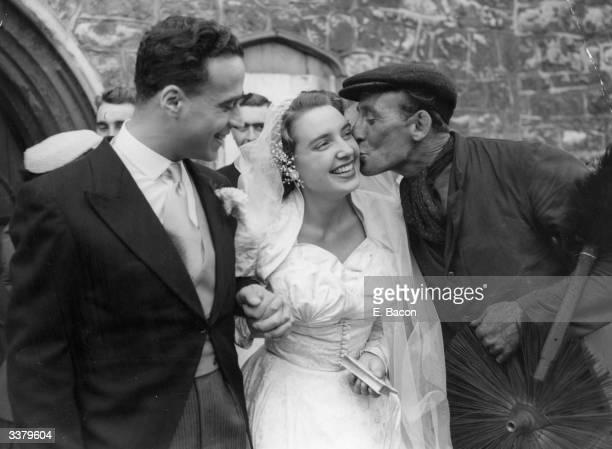 George Harris a chimney sweep kisses Mrs John Forbat a former Sadler's Wells opera singer