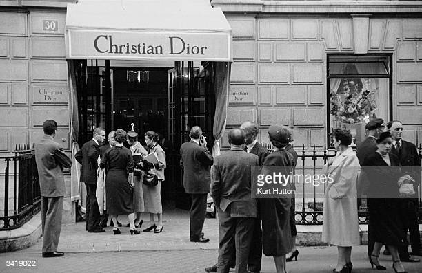 Reporters and fashion pundits mingle outside Christian Dior's boutique in Paris at the launch of the Autumn / Winter collection Original Publication...