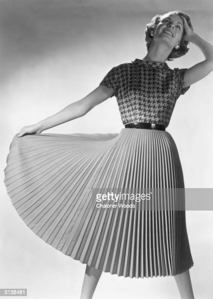 A woman enjoys the sense of liberation that the flared nature of this loose fitting pleated skirt affords her