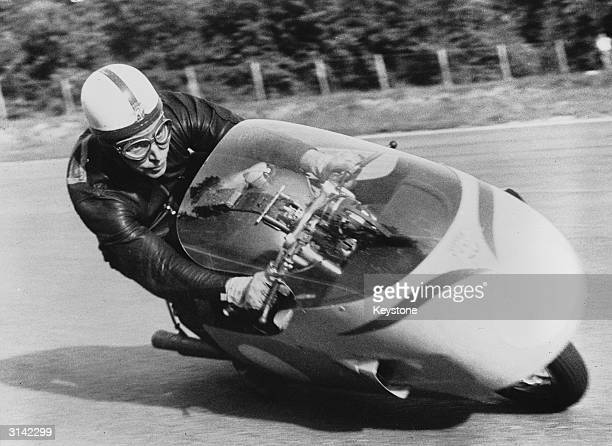 British motorcyclist and racing driver John Surtees practicing for the Grand Prix on the famous Monza track near Milan