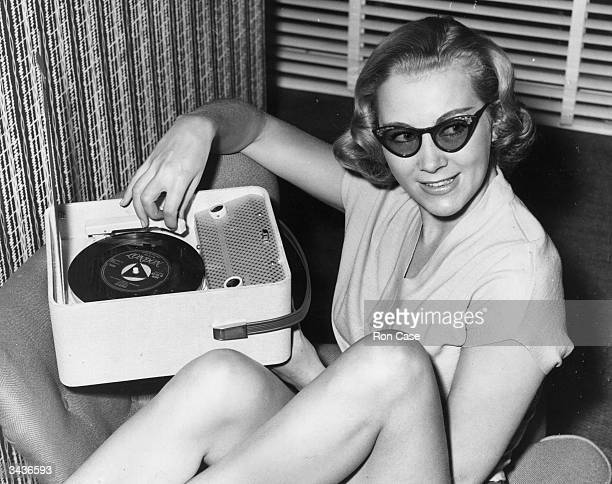 British model Veronica Moon known as 'Grace Kelly's double' demonstrates the world's smallest record player at the Radio Show in Earls Court London...