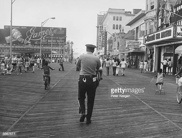 A policeman walking along the boardwalk at Atlantic City New Jersey USA