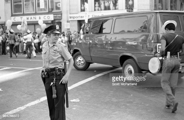 New York City A female police officer stands guard during a labor rally in downtown Manhattan