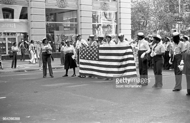 New York City Union workers hold an American Flag and protest the outsourcing of jobs overseas during a rally on 5th Avenue