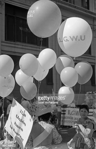 New York City Women from the International Ladies Garment Workers Union hold balloons and protest on 5th Avenue in downtown Manhattan They are...
