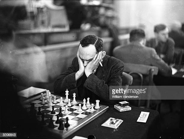 British chess player W Winter in play at the Premier Tournament of the Annual Christmas Congress of the Hastings and St Leonard's Chess Club