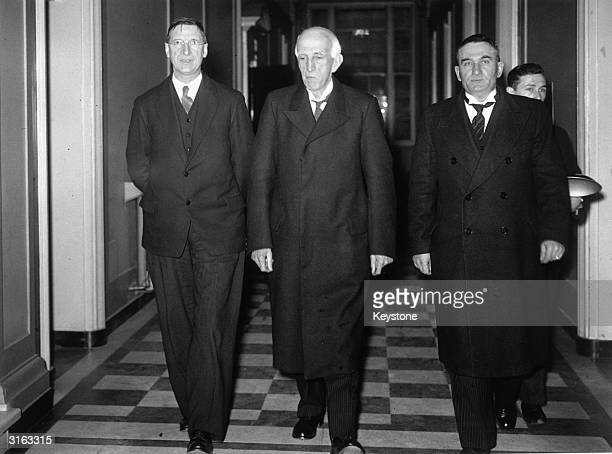 First Taoiseach of the Republic of Ireland Eamon de Valera with Chief Justice O'Sullivan and Frank Fahy in a corridor of the government building in...