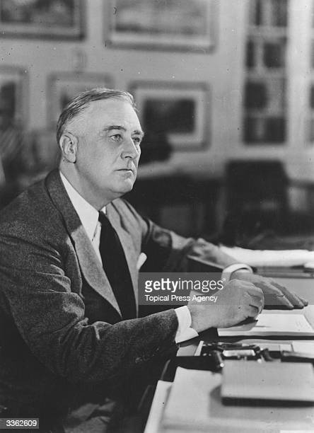 American president Franklin Delano Roosevelt sitting at the desk of his executive office in the White House