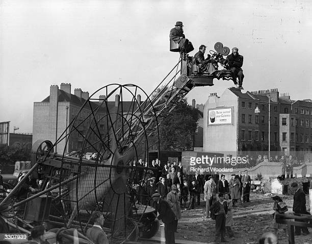 A camera crew in action filming a special angle shot for the Ealing comedy 'Passport To Pimlico' on the custombuilt set in Lambeth London Original...