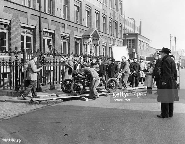 Alec Guinness and members of the unit on location near Ealing studios shooting the final scene of dThe Man in the White Suitf Original Publication...