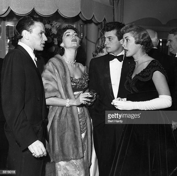 Frank Sinatra and his wife, Ava Gardner with Tony Curtis and his wife Janet Leigh at a party hosted by the Duke of Edinburgh for friends and members...
