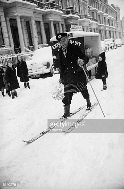 A milkman doing his deliveries on skis at Earl's Court London