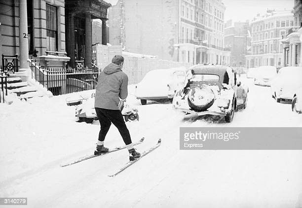 A skier being pulled along behind a car in Earl's Court London