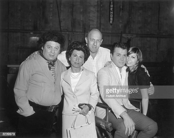 American comedian Marty Allen and American singer Nancy Sinatra pose with Sinatra's mother Nancy Sr and others probably on the set of director Norman...