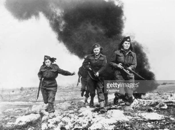 Women who fought in the Partisan war against the Nazis in Yugoslavia training at the Allied base in Italy where they had been recuperating from...