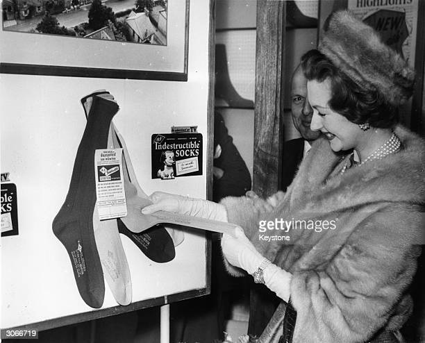 Lady Lewisham looks at some men's socks after opening the 3rd British Hosiery and Knitwear Exhibition in London