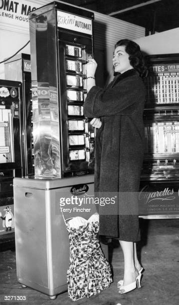 Novelty at the Amusements Trade Fair in London's Westminster, is a vending machine for the sale of bikinis. Miss Margaret Rowe, Miss England 1955,...