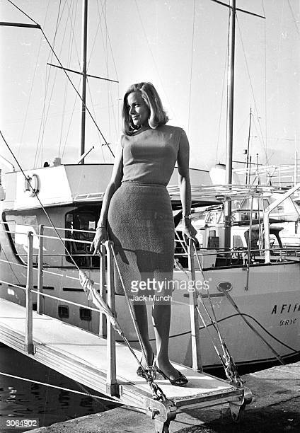 Actress Honor Blackman poses on a gangplank
