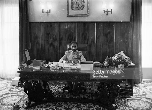 Emperor Haile Selassie of Ethiopia at his desk in the palace office in the capital Addis Ababa
