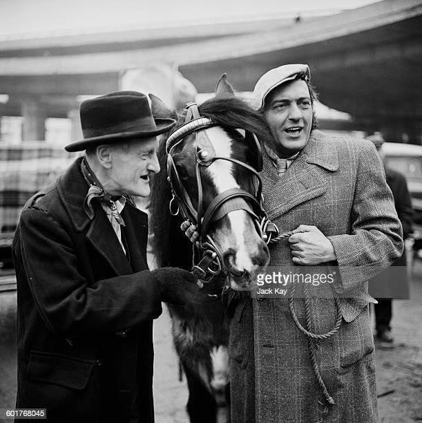 Actors Wilfrid Brambell and Harry H Corbett in character to publicise the latest series of the British sitcom 'Steptoe and Son' UK