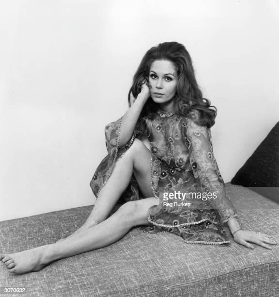 Actress Joanna Lumley models an embroidered chiffon dress