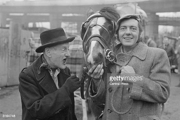 Harry H Corbett and Wilfrid Brambell stars of the popular TV series 'Steptoe and Son' with their carthorse 'Hercules'