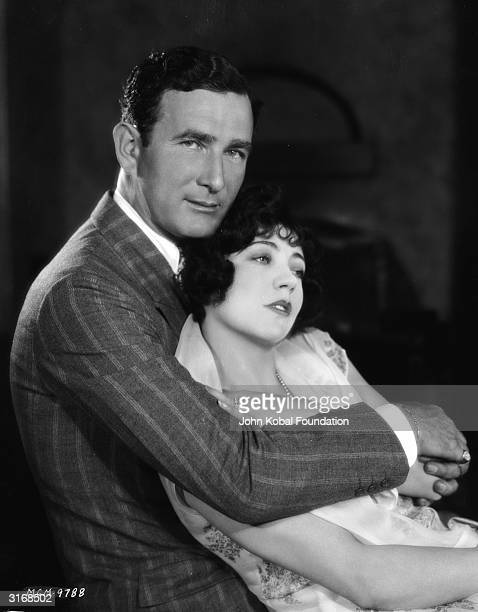 French actress of the silent era Renee Adoree relaxes in a loving embrace with her husband William Gill