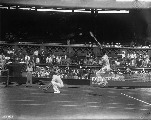 American pair Wilmer Allison and John Van Ryn in play against G Pat Hughes and Raymond Tuckey of Great Britain in the Davis Cup doubles match at...