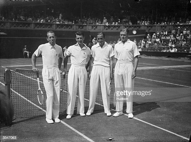 Wilmer Allison and John Van Ryn of the USA with their British opponents Pat Hughes and Raymond Tuckey on centre court prior to their doubles match at...