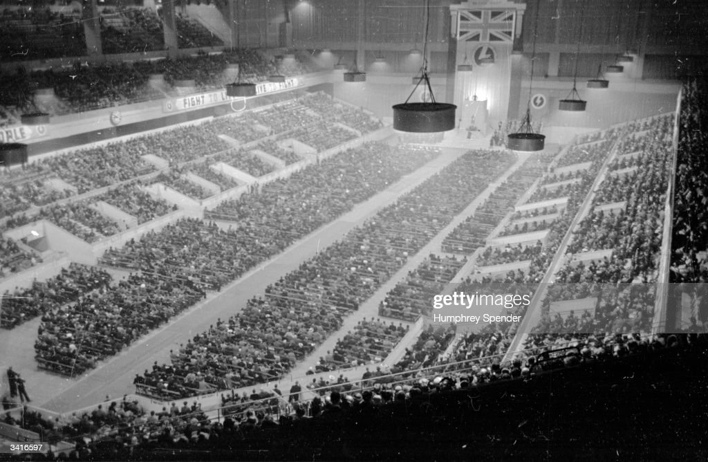 A meeting of the British Union of Fascists, at Earl's Court, London, where Sir Oswald Ernald Mosley (1896 - 1980), founder of the BUF makes a two hour speech. Original Publication: Picture Post - 187 - Fascist Meeting - pub.1939