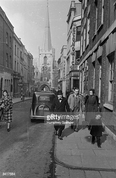 Broad Street one of Bristol's many narrow streets with St John's Church above the city gateway Original Publication Picture Post 189 Bristol pub 1939