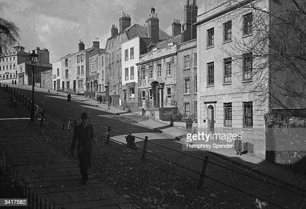Long shadows across St Michael's Hill one of the many steep streets in Bristol Original Publication Picture Post 189 Bristol pub 1939