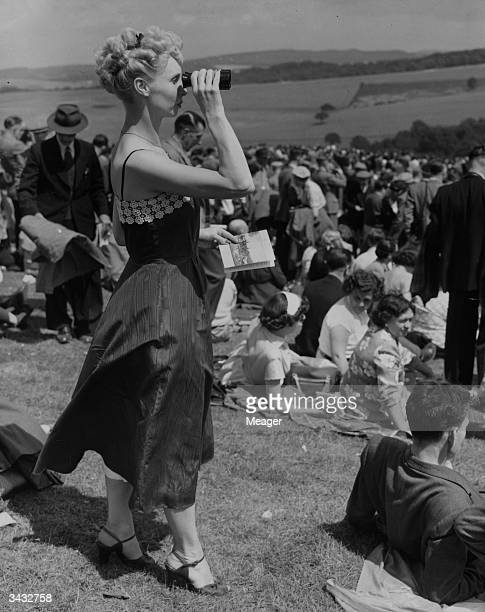Cecilia Austin watching the Stewards Cup race on Trundle Hill on the first day of the races at Goodwood