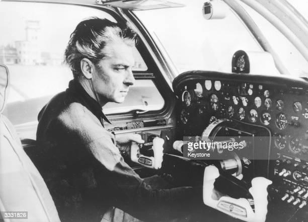 Austrian conductor Herbert von Karajan at the controls of an aeroplane at Salzburg