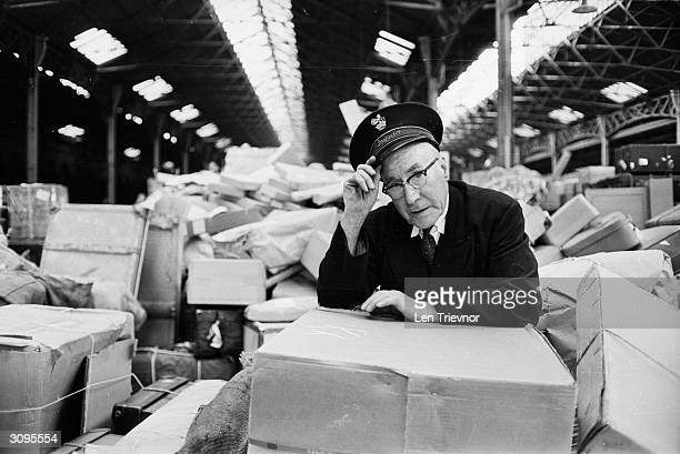Inspector Walter Pepper of British Rail with a roomful of parcels waiting for delivery.