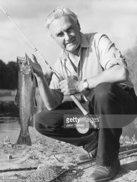 29th July 1966, Fisherman Colonel R G Cross of Feltham, Middlesex, with a freshly caught Brown Trout at 'Two Lakes' near Romsey, Hampshire.