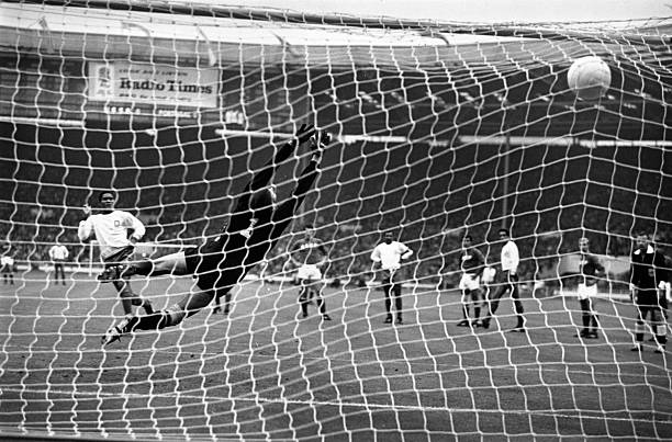 Portugal's Eusebio hammers his penalty kick past Russia's Lev Yashin, to put his country in the lead during the World Cup third place play off game...