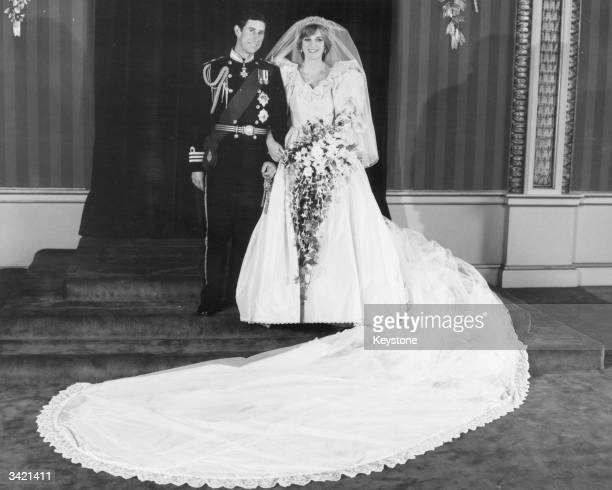 Charles Prince of Wales and Diana Princess of Wales in the throne room of Buckingham Palace after their wedding at St Paul's Cathedral London